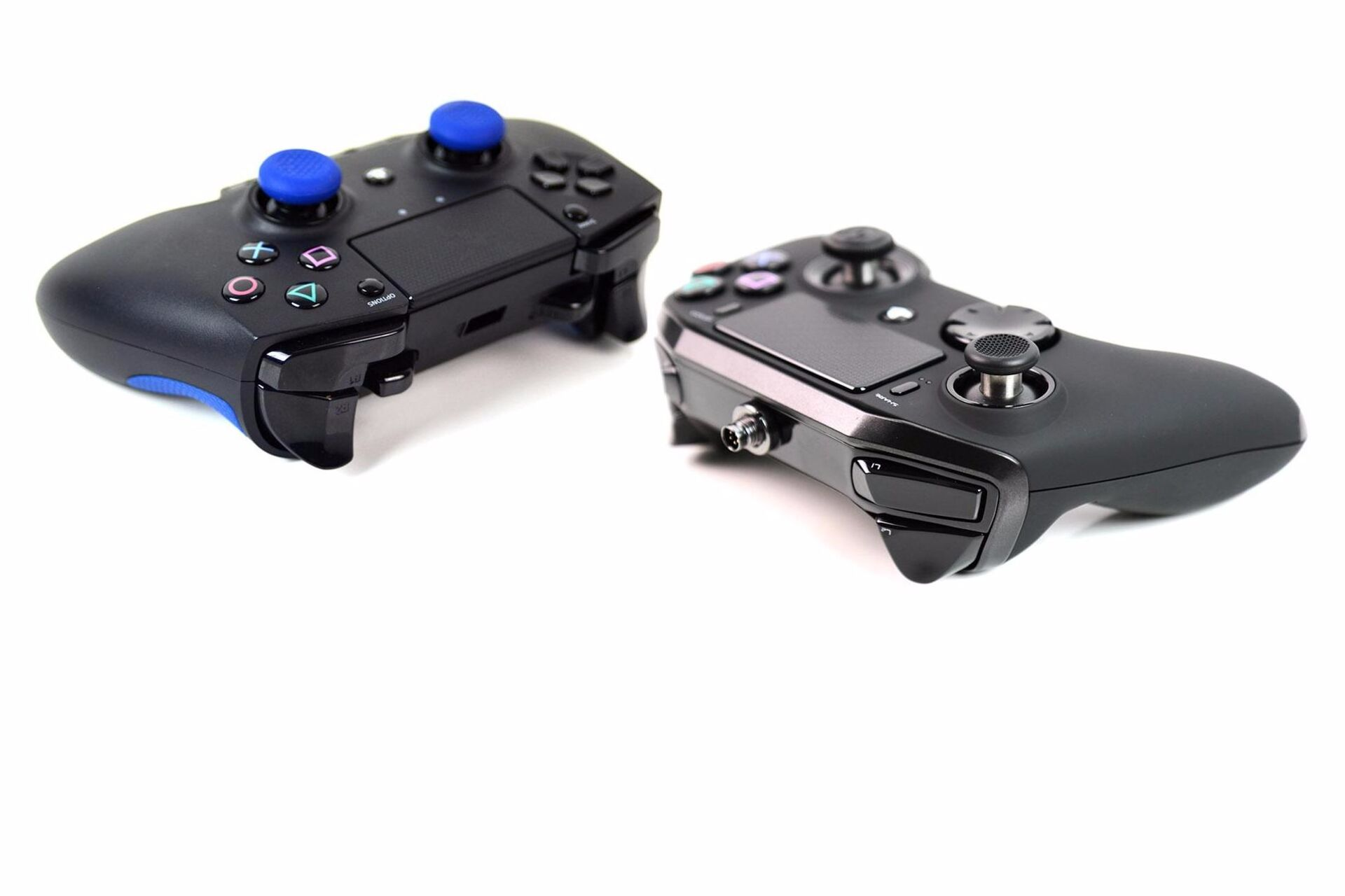 Ps4 Premium Joypad Face Off Razer Raiju Vs Nacon Revolution Pro Eurogamer Net Take your play to competitive esports level with these officially licensed controllers designed for pro gamers and optimised for ps4. razer raiju vs nacon revolution pro