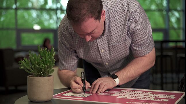 Jagex boss Phil Mansell signing the Time to Change pledge