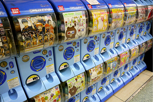 Gacha mechanics are derived from Gachapon machines, which dispense physical toys at random