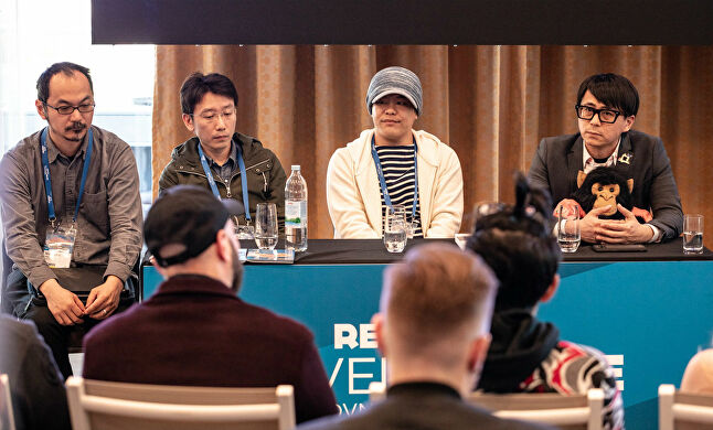 Swery (far right) speaking as part of a panel on the Japanese industry at Reboot Develop Blue
