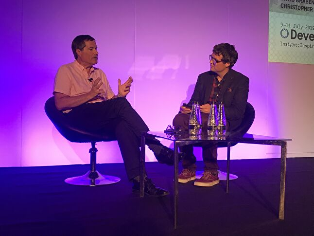 Frontier Developments CEO David Braben on stage at Develop:Brighton 2019 with GamesIndustry.biz's Chris Dring