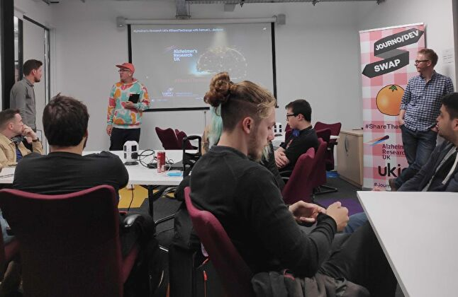 The participating journalists await the reveal of the game jam's theme