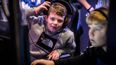 Kids playing the games on offer at EGX