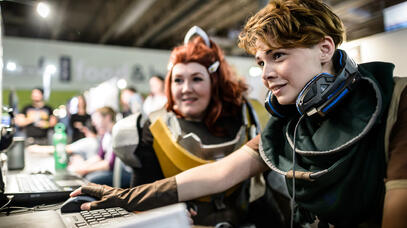 Two cosplayers on a computer game