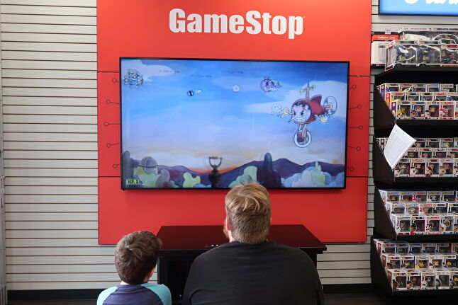 Every GameStop concept store has at least one couch, and customers can either play together, or play separate games next to one another on the same, split-screen