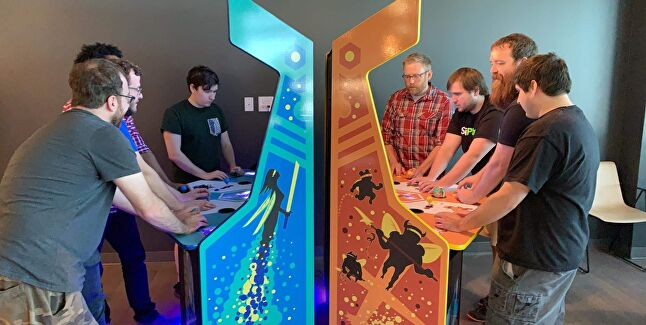 The SciPlay team playing Killer Queen at their office